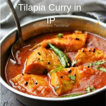 Tilapia fish curry served in an aluminum plate