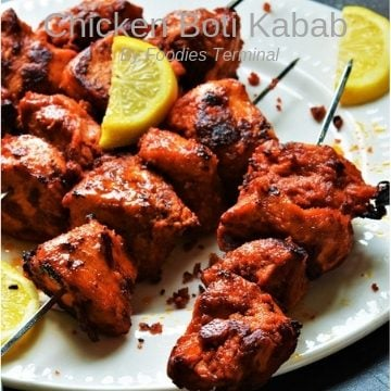 Chicken Boti Kabab served with lemon wedges