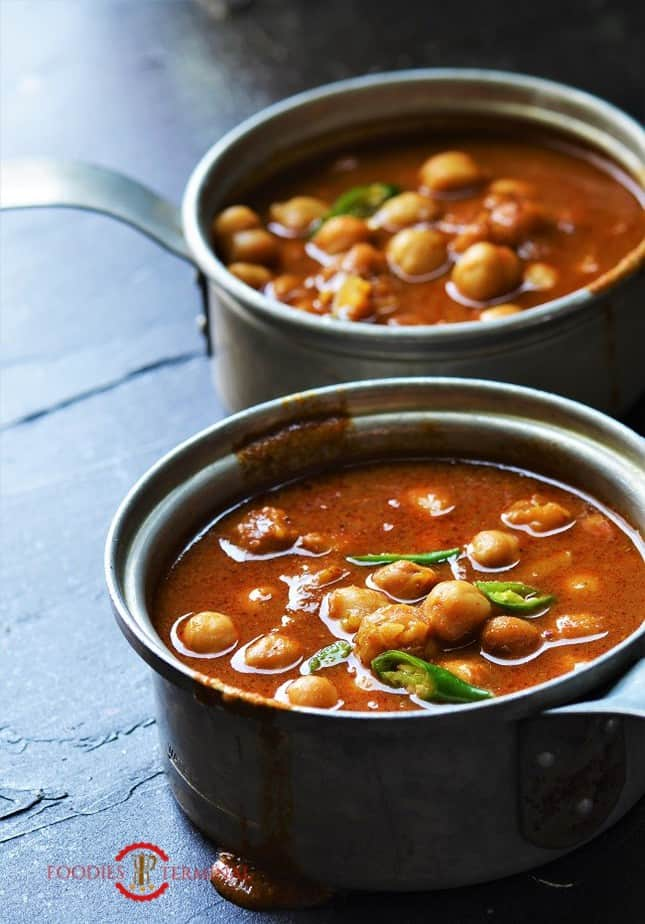 Instant Pot Chana Masala served in two small aluminum saucepans