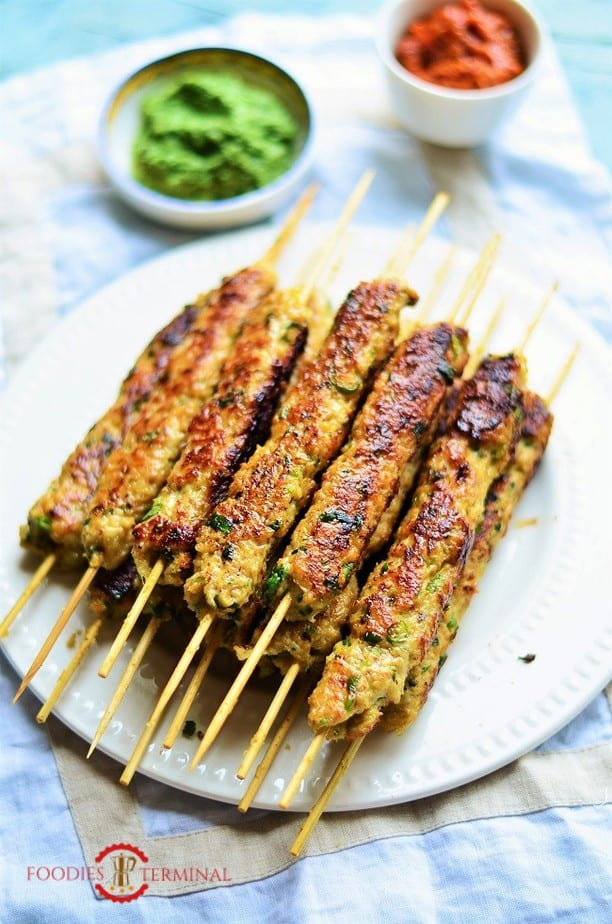 chicken seekh kabab on bamboo skewers on a big pile