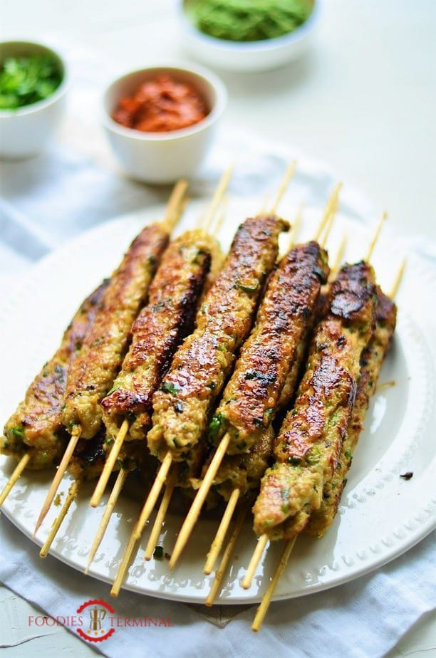 Chicken Seekh Kabab stacked on a white plate