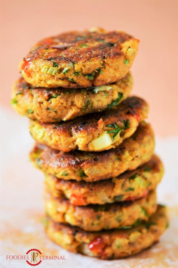 Salmon patties with flour stacked high vertically