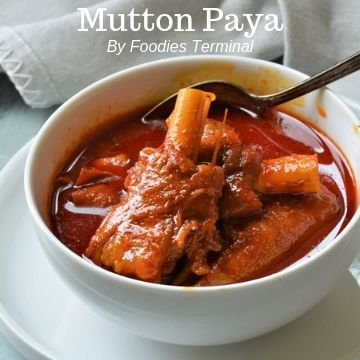Mutton Paya in a white bowl with goat trotters