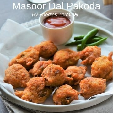 Masoor Dal Pakoda served on a white plate