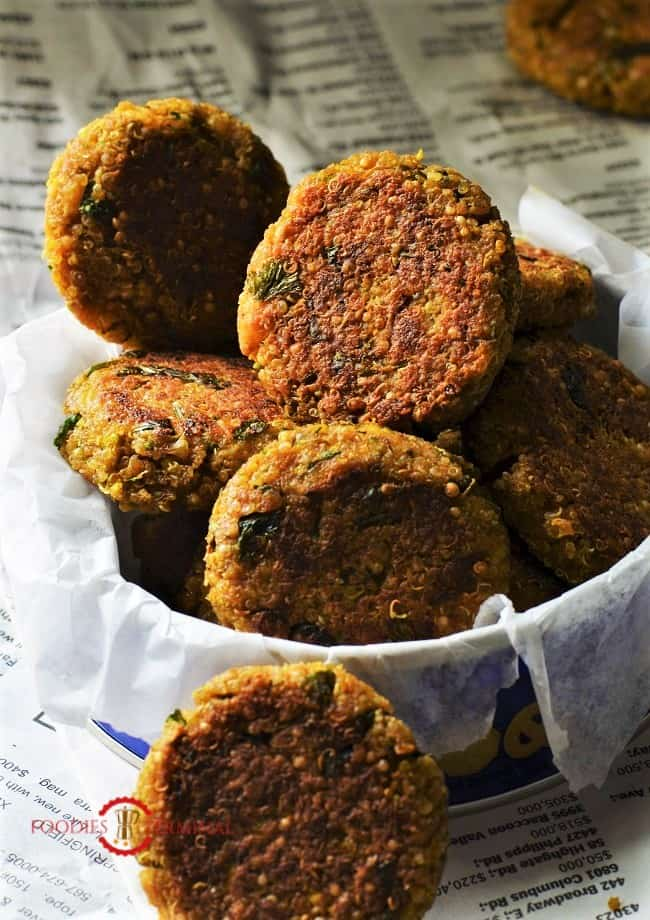 Quinoa paneer cutlets clustered in a small box