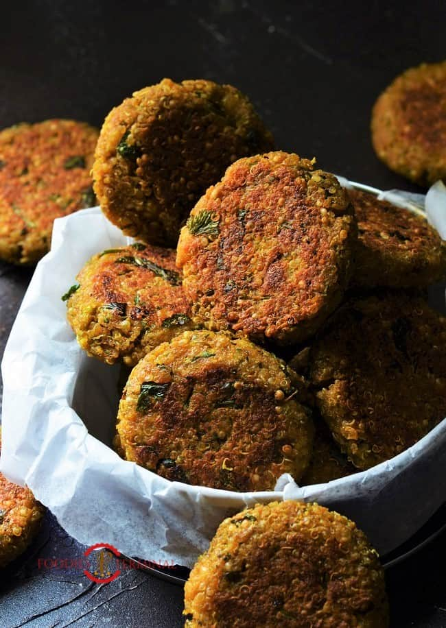Quinoa Patties kept in a small box layered with parchment