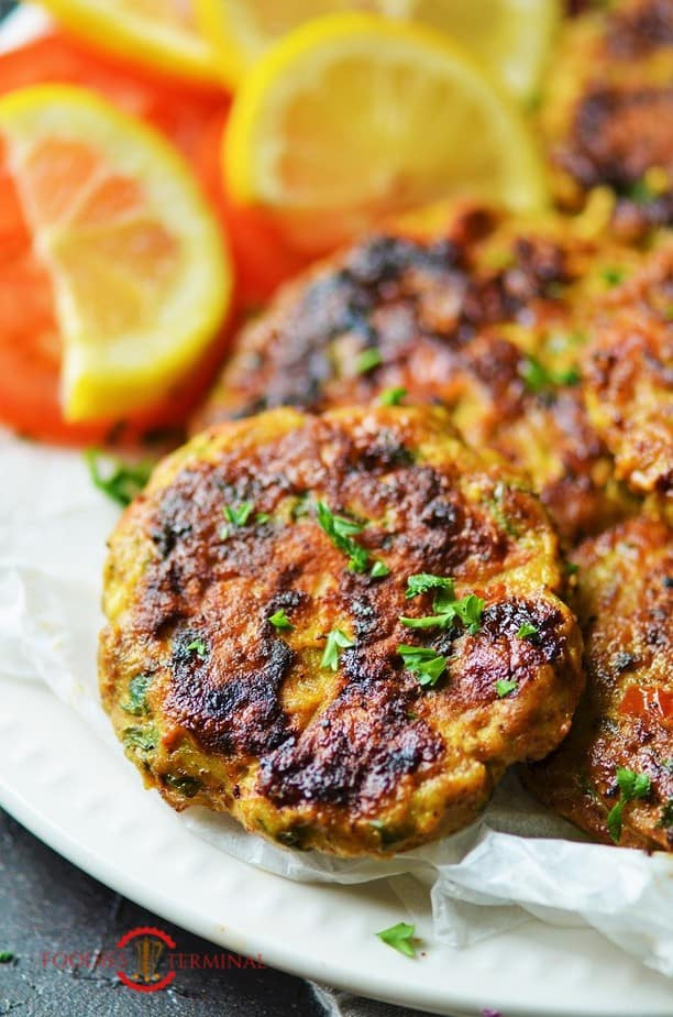 Chicken Chapli Kabab served with lemon wedges