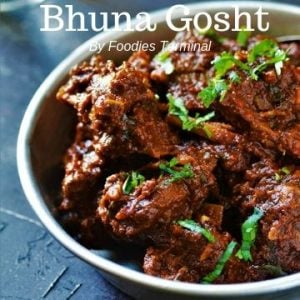 Bhuna Gosht cooked with Goat meat garnished with cilantro