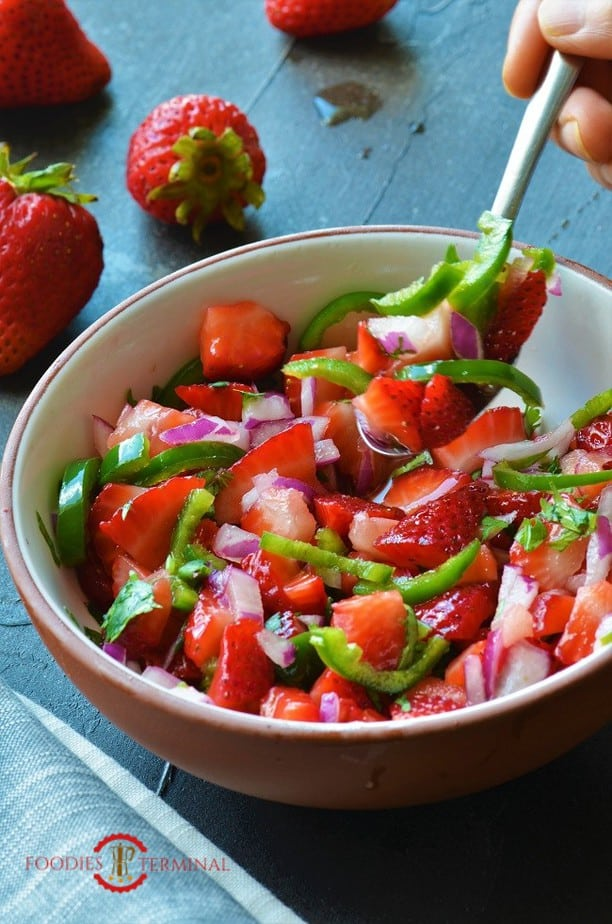 Strawberry Jalapeno Salsa in a terracotta rimmed bowl