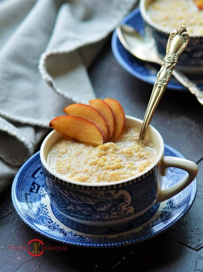 Sweet Dalia served in a cup garnished with peaches