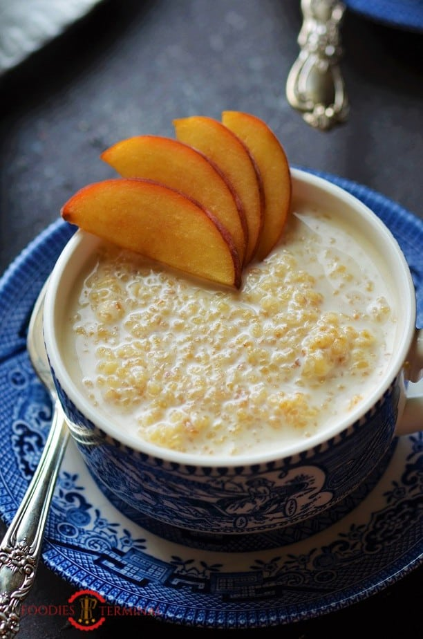 Instant pot Cracked wheat porridge in a cup with sliced peaches