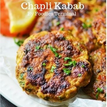Chicken Chapli Kabab garnished with cilantro