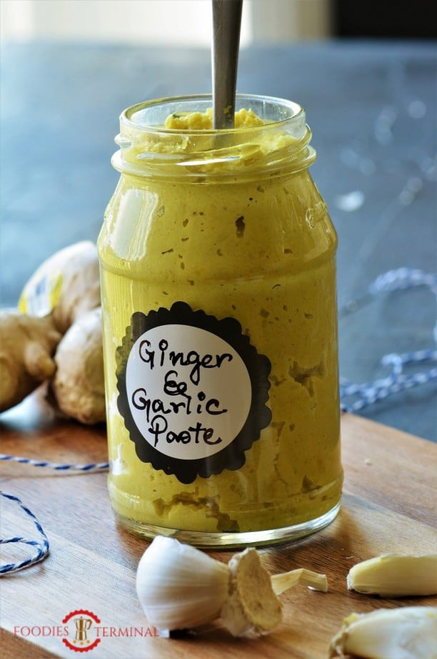Ginger Garlic paste recipe in a glass bottle with a spoon