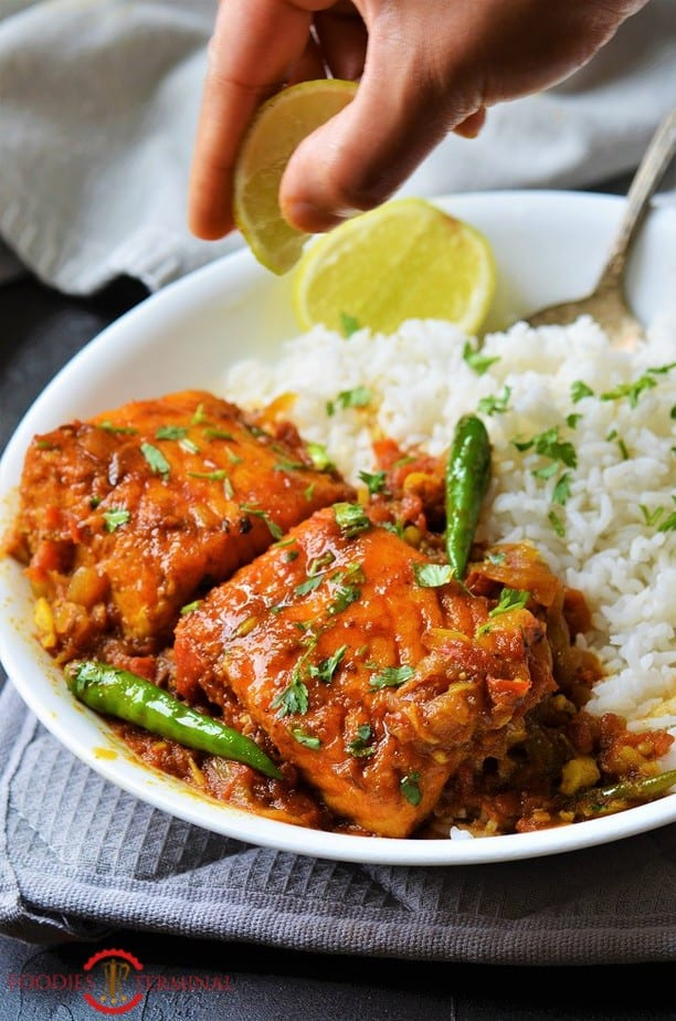 Salmon Curry Indian style served with white rice & green chilies