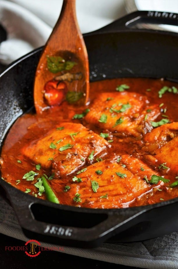 Easy Salmon curry in a red sauce served in an iron black wok