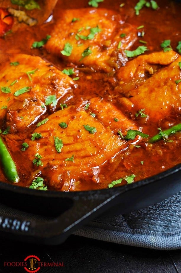 Indian Salmon curry cooked with Salmon fillet in a red sauce