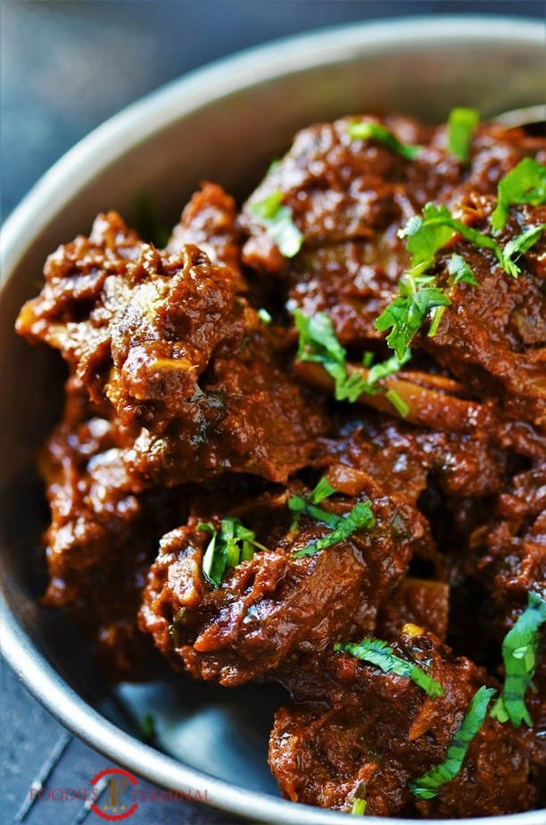 Pakistani Mutton bhuna garnished with cilantro