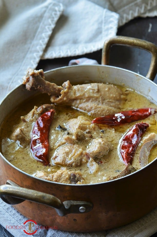 Aminias style Chicken rezala Kolkata style in a pot with brass handles