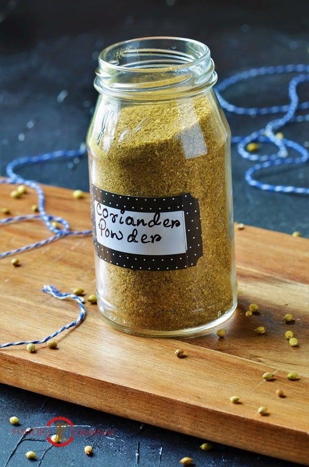 Homemade coriander powder in a glass jar