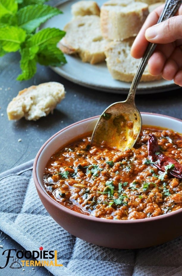 Pakistani chicken keema in a bowl with a dipping spoon
