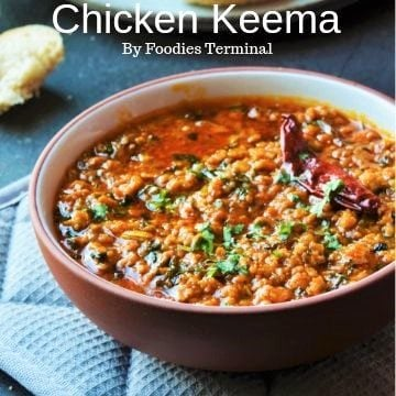 Chicken Keema recipe garnished with cilantro in a bowl