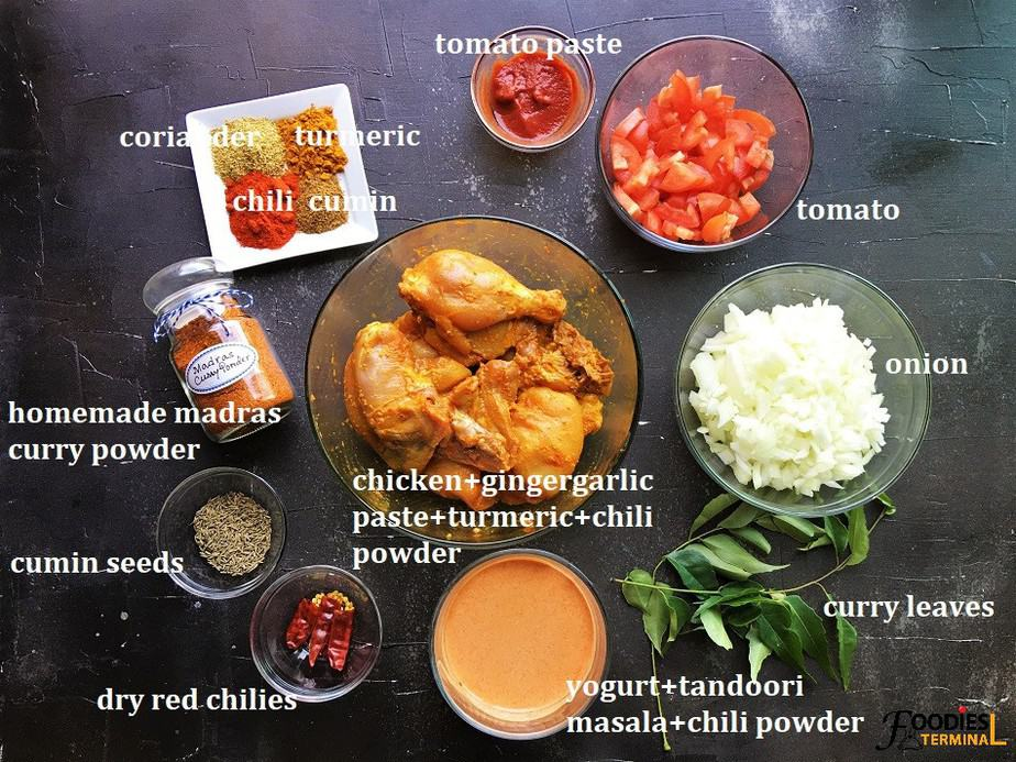 Chicken Madras Recipe Instant pot ingredients in bowls on a black surface