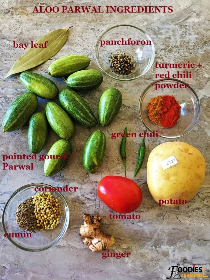 Aloo Parwal ki sabzi ingredients on a grey board