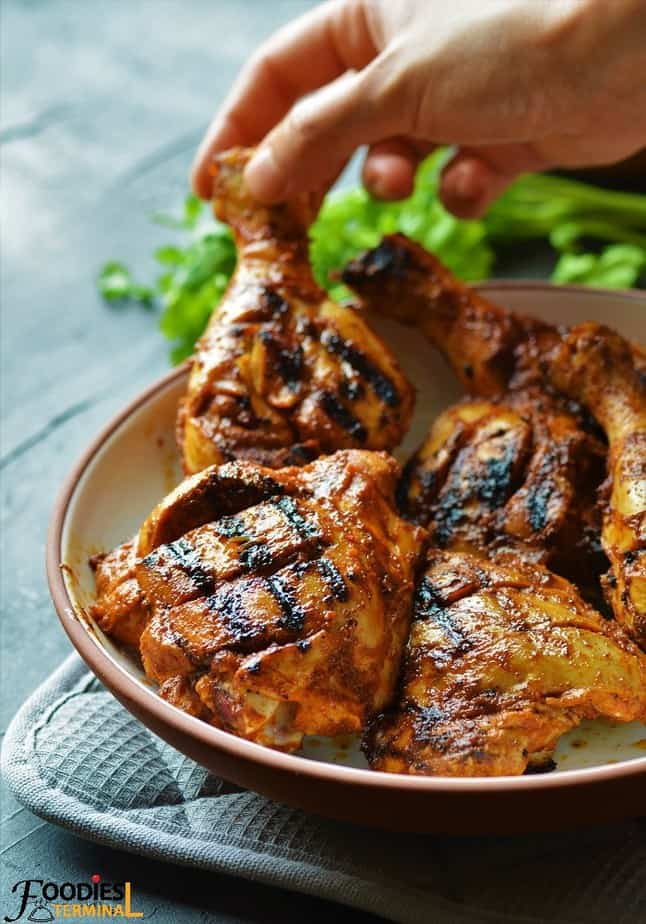 Nando's Peri Peri Chicken being lifted from a bowl