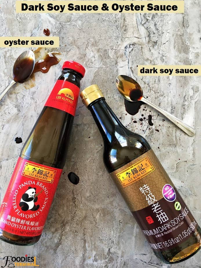 Oyster Sauce & dark soy sauce bottles with spoonful by the side