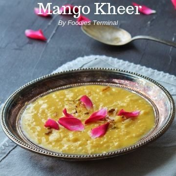 Mango rice kheer in a silver plate with rose petals