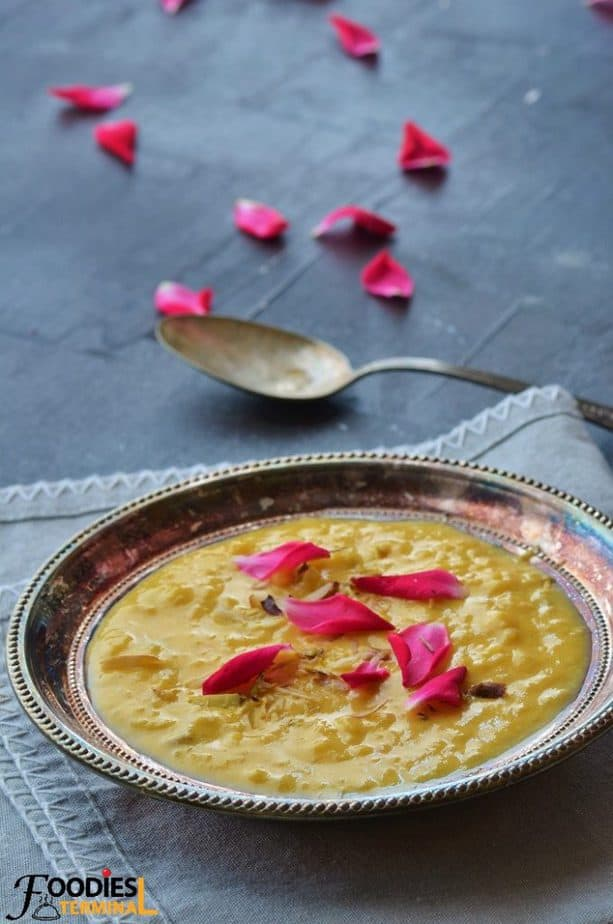 Mango kheer on a silver silver plate on a grey linen