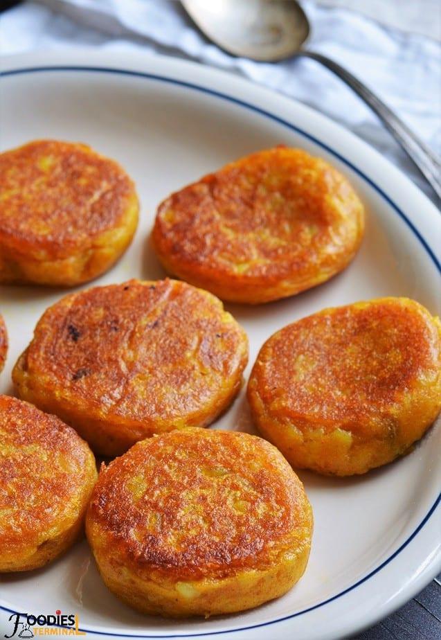 Golden skillet roasted Potato patties on white plate