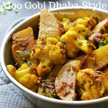 aloo gobi dhaba style served in a metal plate