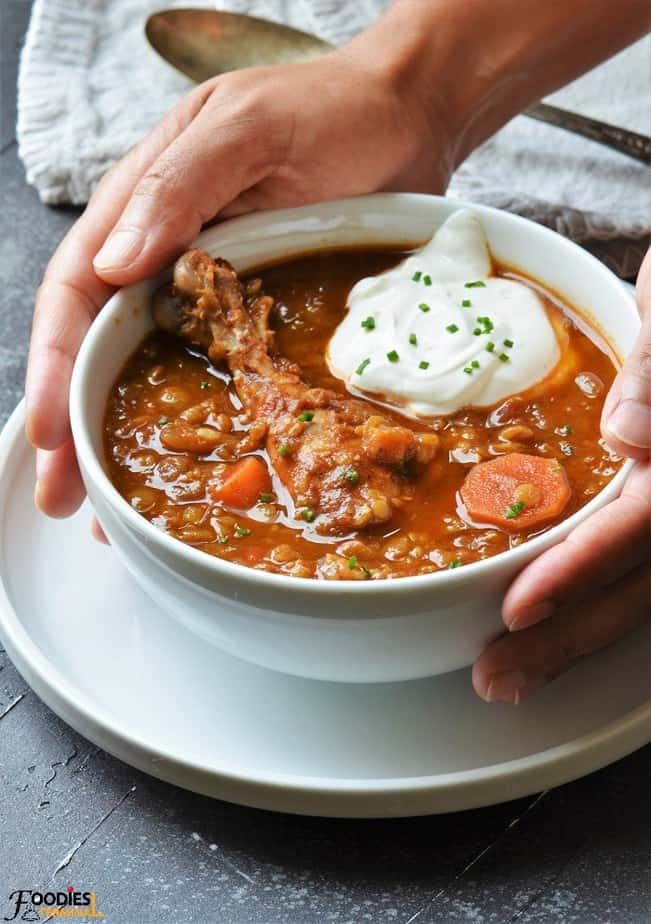 slow cooker chicken lentil stew recipe in white bowl