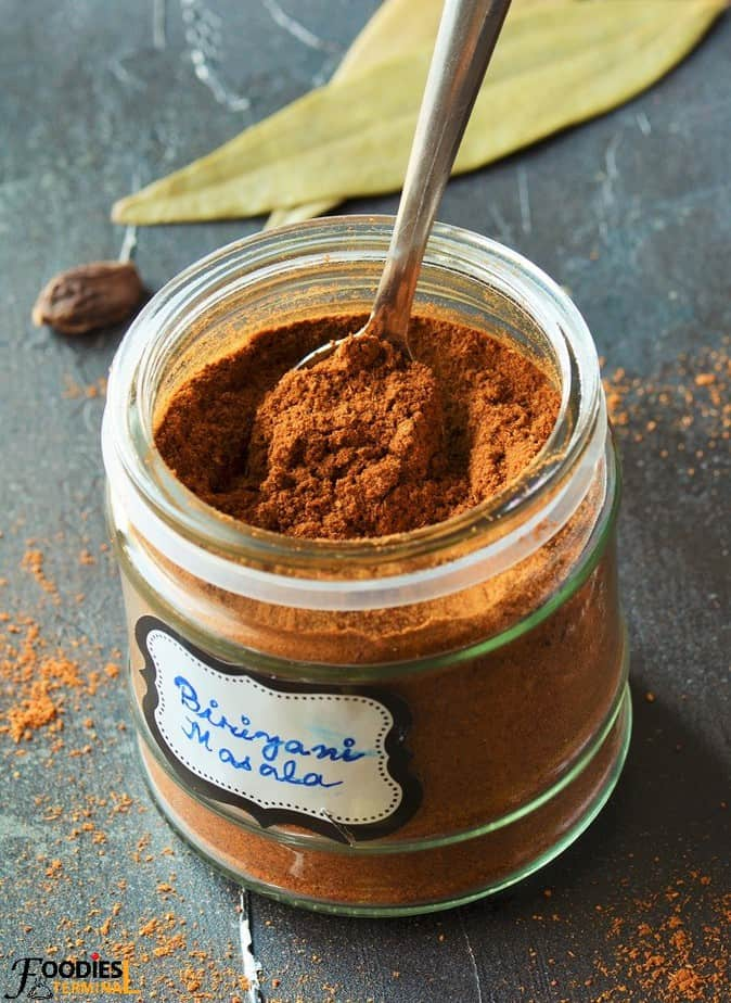 Pakistani Biriyani masala powder in a jar with a spoon