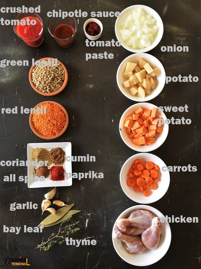 lentil chicken stew recipe ingredients in bowls on a black surface