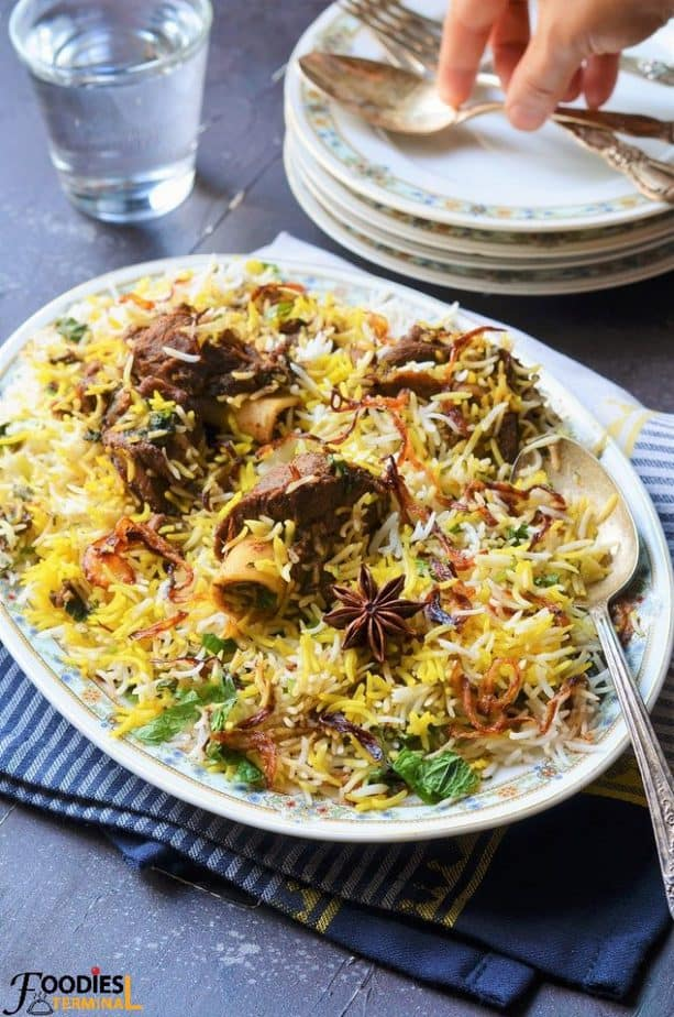 Easy Mutton Biryani recipe with mutton on the bones on top