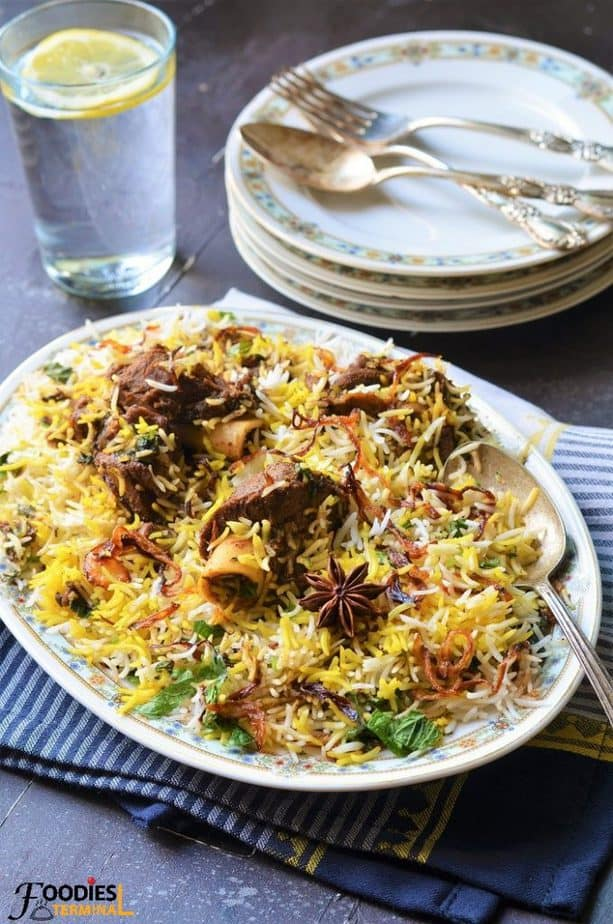 Special Mutton Biryani served with a glass of water
