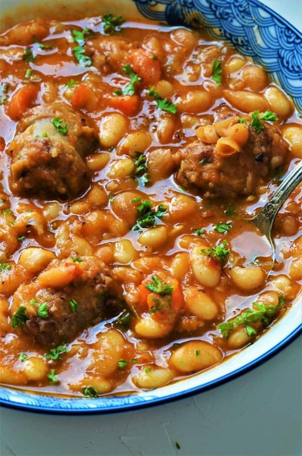 Sausage and Beans stew garnished with parsley