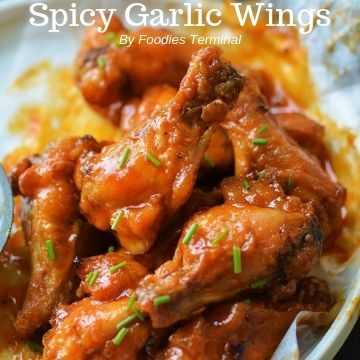 spicy garlic wings garnishe with chives