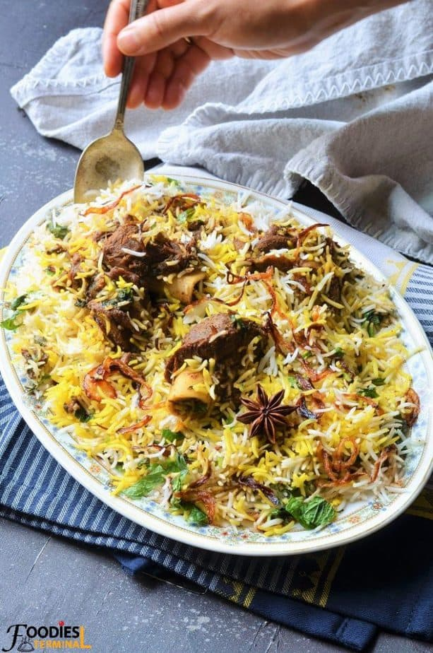 Dum Mutton Biryani recipe being lifted with spoon