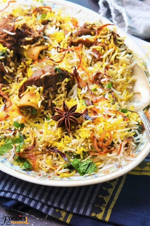 Indian Mutton Biryani opped with birista & a spoon