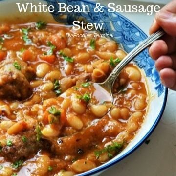 Creamy bean and sausage stew in a bowl