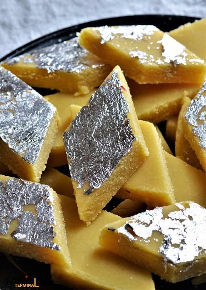 Badam Burfi with almond flour piled on a plate