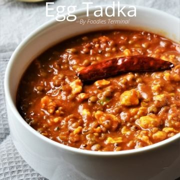 egg tadka bengali style in white bowl