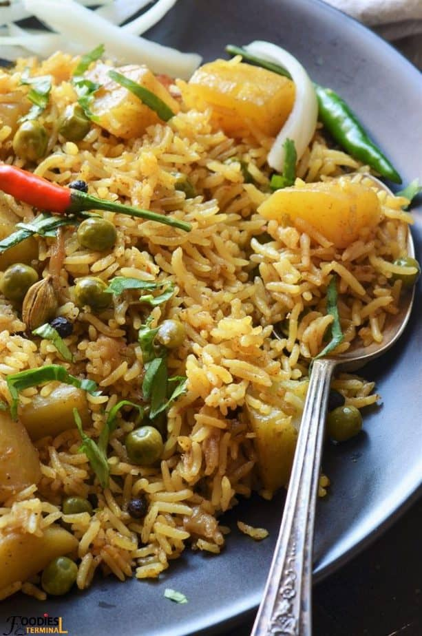 Aloo Matar Pulao garnished with cilantro