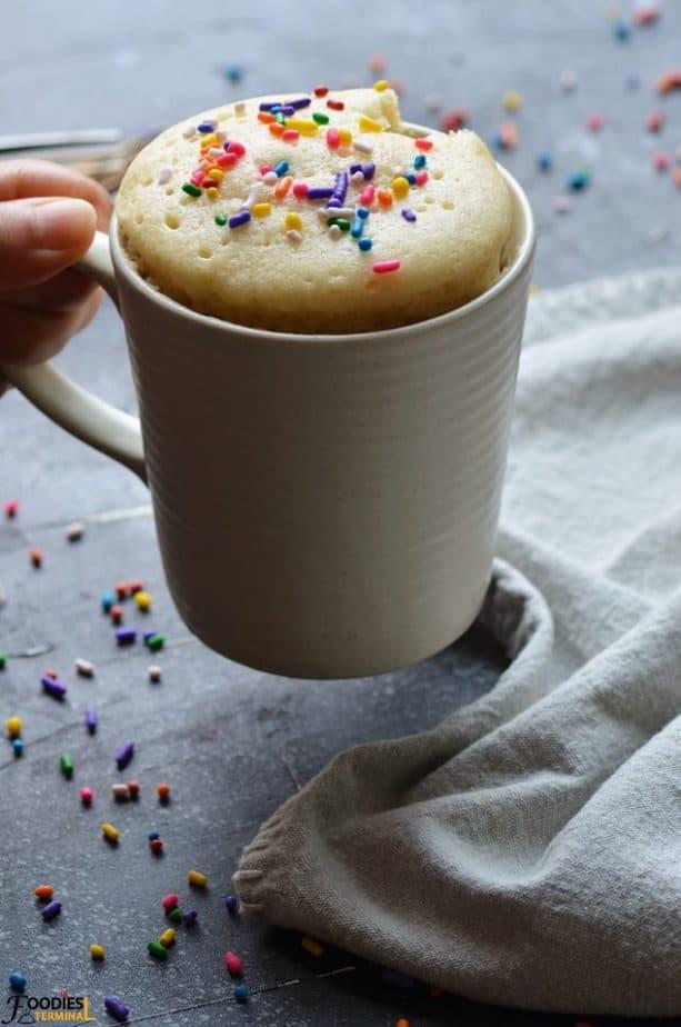 Vanilla mug cake no egg recipe in a mug with sprinkles on top