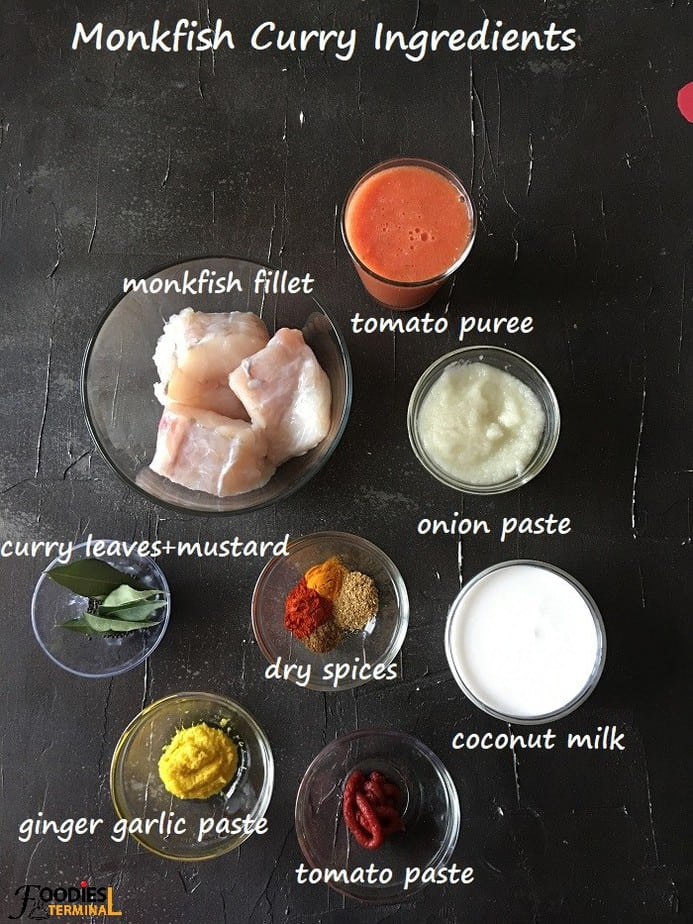 Indian style monkfish curry ingredients in bowls on a black surface