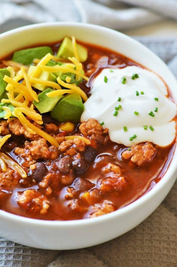 Easy Instant Pot Turkey Chili with cheese, avocado & cream