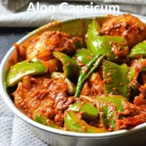 Aloo Capsicum dry curry in a metal plate